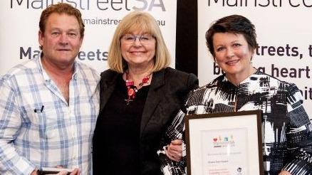 Graham Knaggs and Anne Johnson accept award